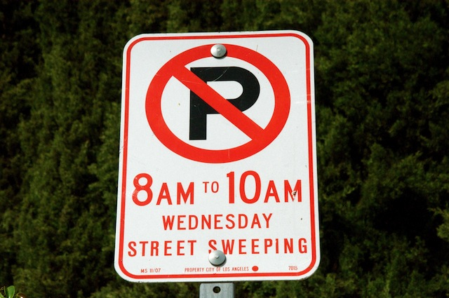 street sweeping parking sign